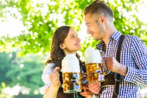 German couple in Tracht drinking beer